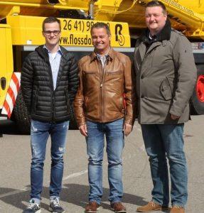 Команда Dietmar Flossdorf, забирающая кран, (слева на право) Марко и Дитмар Флоссдорф со Стефаном Васмутом